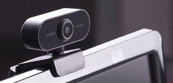 Webcam befestigt an einem Bildschirm